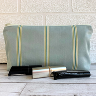 Duck egg blue make up bag with narrow turquoise, lime and white stripes