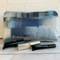 Blue make up bag with abstract squares pattern