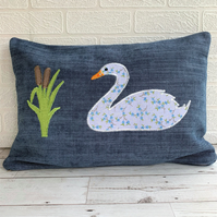 Blue rectangular cushion with swan and bulrushes