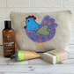 Chicken toiletry bag, wash bag in cream fabric with mauve and turquoise chicken