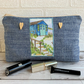 Large blue make up bag with beach hut decorative panel