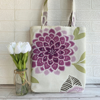 Floral tote bag in cream with a large purple flower