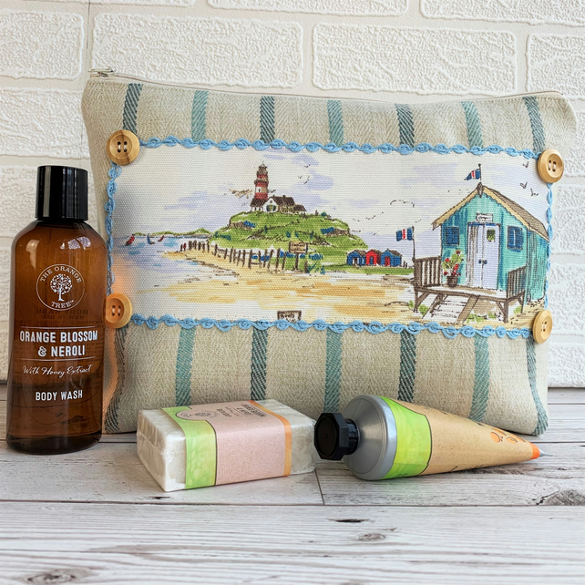 Toiletry bag with beach huts and lighthouse coastal decorative panel
