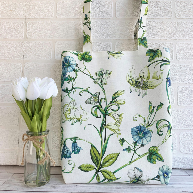 Floral tote bag with cream and blue flowers and cream butterfly