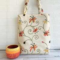Floral tote bag in embroidered floral fabric with orange and yellow lilies