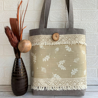Woodland tote bag with acorns print panel and tasselled lace trim