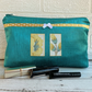 Large turquoise make up bag with golden yellow floral panels