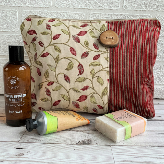 Woodland toiletry bag with leaf and stripes pattern and wood button