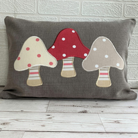 Toadstools cushion with three spotty toadstools