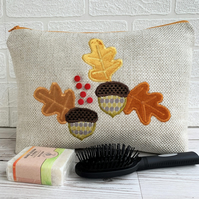 Autumn toiletry bag, wash bag in cream fabric with velvet oak leaves and acorns