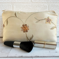 Floral make up bag in embroidered gold fabric