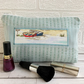 Large duck egg blue make up bag with beach and boats decorative panel