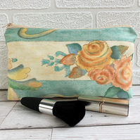 Striped and floral make up bag with a cluster of roses