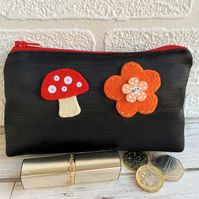 Large black satin coin purse with orange and red felt flower and mushroom