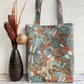 Wildlife tote bag with butterflies and other insects on leaves