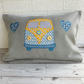 Campervan cushion in grey with blue and yellow campervan