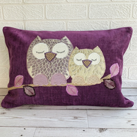 Sleepy owls cushion with lilac and gold owls on a purple cushion