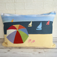 Beach scene cushion with parasol and yachts