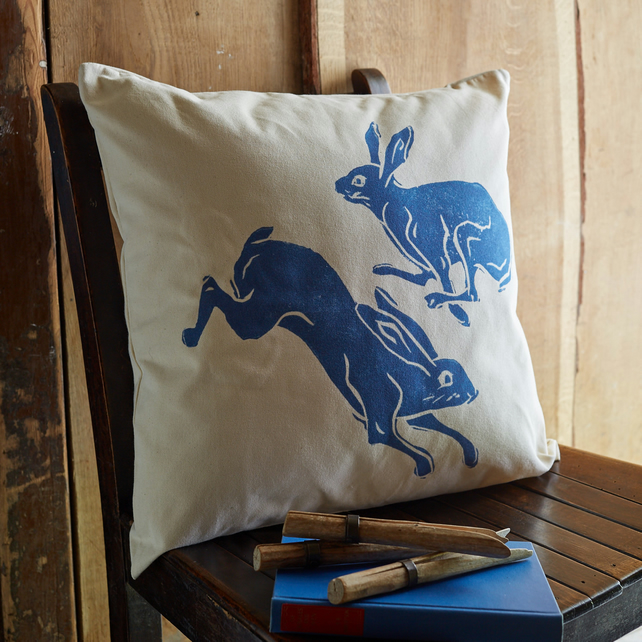 Natural canvas cushion with Leaping Hares.
