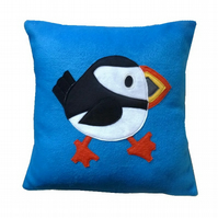 Turquoise Puffin cushion