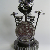 "Drummer ""Bash"" metal sculpture made from re-cycled automotive components"