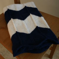 Navy blue and white knitted chevron baby blanket