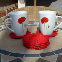 Set of six hand made crochet coasters in bright red cotton yarn.