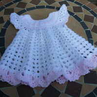 Hand made crochet baby dress in a delicate shell stitch