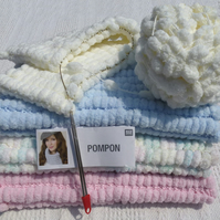 Luxurious, soft and warm baby blanket. Hand knitted from Rico POMPON yarn.