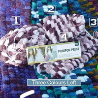 Hand knitted scarf in Rico Pompon Print yarn. Amazingly soft and warm.