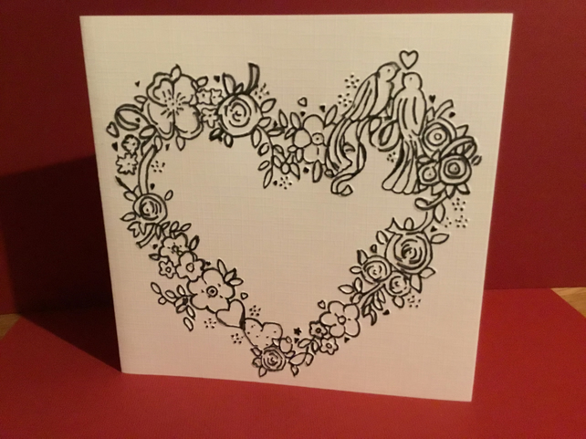 Embossed card featuring two love birdss in a heart JM404