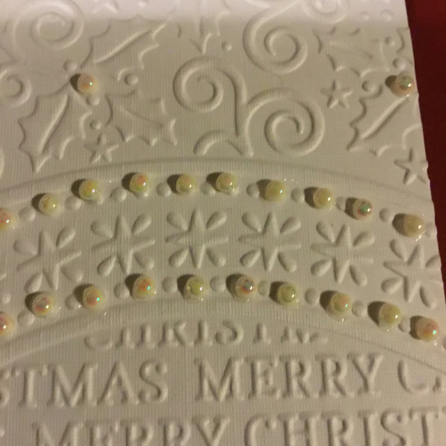A beautifully embossed Christmas Card