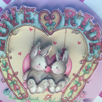 A pretty Congratulations card featuring to love bunnies