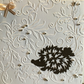 Pack of four embossed Christmas cards with a cute hedgehog and sparkle.
