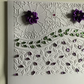 A large, embossed floral card suitable for any occasion.