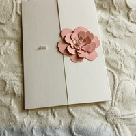 Pretty blank card topped with a hand made flower