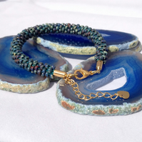 Dark Teal Picasso Beaded Kumihimo Bracelet