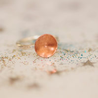 Sterling silver ring with copper round