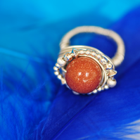 Sterling silver wire ring with round sand stone bead