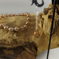 pearl bracelet with matching earrings
