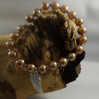 pearl bracelet with angel wing charm