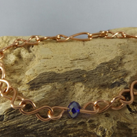 copper bracelet with blue crystal
