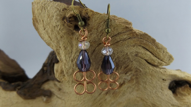 Copper dangle earrings with purple and white crystal