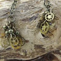 Bronze chain dangle earrings with cogs and wheels of watch steam punk