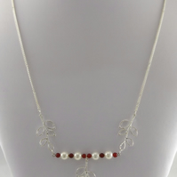 White shell pearl necklace with silver leaf charms 24""