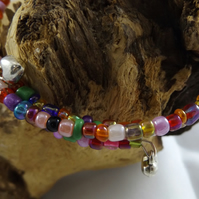multi coloured memory wire bracelet with silver plated heart charms