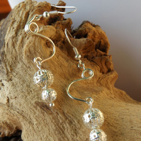 Silver plated dangle earrings with filigree design