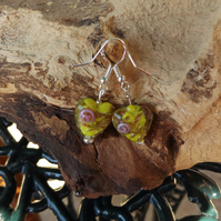 Glass heart shaped yellow earrings with pink rose motif