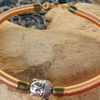 "7.5"" copper wire bracelet with copper gizmo wire cover and buddha charm"
