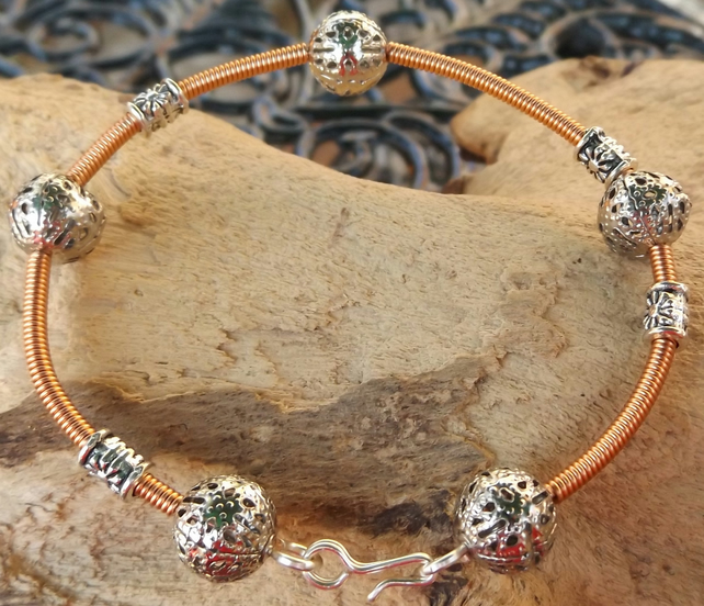 "7.5"" silver plated bracelet with copper gizmo wire cover"